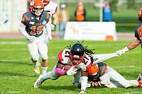 KELOWNA, BC - OCTOBER 6: Conor Richard #10 of Okanagan Sun tackles Andre Goulbourne #21 of the VI Raiders at the Apple Bowl on October 6, 2019 in Kelowna, Canada. (Photo by Marissa Baecker/Shoot the Breeze)