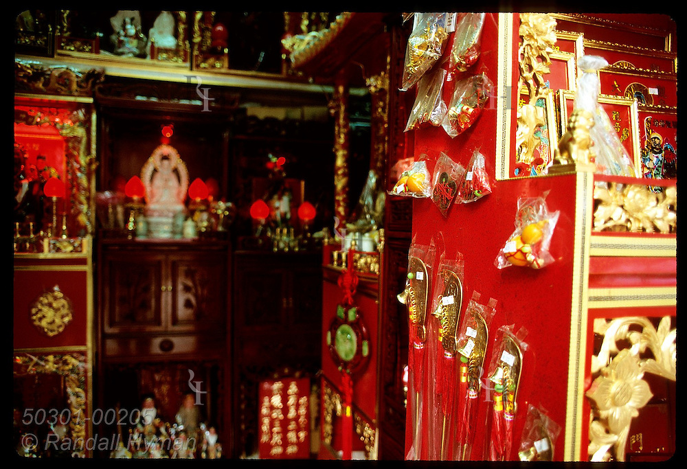 Feng Shui and Buddhist items share space in specialty shop in Kowloon's Yau Ma Tei district. Hong Kong