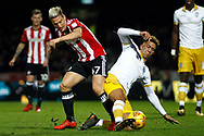 Liam Palmer of Sheffield Wednesday (R) tackles Sergi Canos of Brentford (L). EFL Skybet football league championship match, Brentford v Sheffield Wednesday at Griffin Park in London on Saturday 30th December 2017.<br /> pic by Steffan Bowen, Andrew Orchard sports photography.