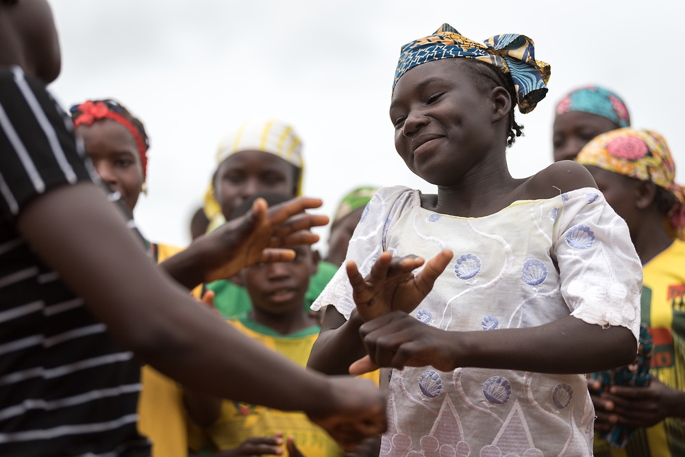 3 June 2019, Djohong, Cameroon: Children dance as part of an intercultural event at the 'Ecole Publique de Borgop 2' (Public School of Borgop 2). Borgop 2 teaches children from the Borgop camp for Central African Republic refugees, and concerted efforts are being made by local authorities in collaboration with the Lutheran World Federation to encourage peaceful cohabitation among refugees of different ethnic groups and religions, and with host communities in the area. The Borgop refugee camp is located in the municipality of Djohong, in the Mbere subdivision of the Adamaoua regional state in Cameroon. Supported by the Lutheran World Federation since 2015, the camp currently holds 12,300 refugees from the Central African Republic.