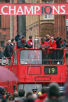 Football - Manchester United Premier League Champions Parade<br /> The team bus passes under a champions banner on Deansgate, Manchester