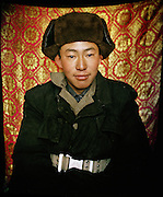 Portrait of young camel herder and singer Abdul Sator..Campment of Ortobil (Sufi), all the way at the end of the Little Pamir, near the Tajik/China border. .Winter expedition through the Wakhan Corridor and into the Afghan Pamir mountains, to document the life of the Afghan Kyrgyz tribe. January/February 2008. Afghanistan