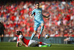 Arsenal's Hector Bellerin (left) and Burnley's Stephen Ward battle for the ball