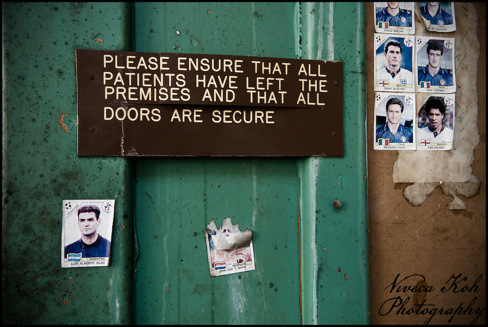 Sign on a door in abandoned mental asylum