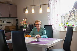 Senior woman drinking coffee at home