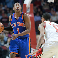 17 December 2009: New York Knicks guard Chris Duhon brings the ball upcourt while Chicago Bulls guard Derrick Rose defends on him during the Chicago Bulls 98-89 victory over the New York Knicks at the United Center, in Chicago, Illinois, USA.