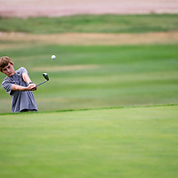 072313        Brian Leddy<br /> Logan Willis practices his chip shot during a Junior Golf class at Fox Run Golf Course Tuesday July 23.