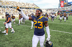Nov 14, 2020; Morgantown, West Virginia, USA; West Virginia Mountaineers safety Tykee Smith (23) celebrates after defeating the TCU Horned Frogs at Mountaineer Field at Milan Puskar Stadium. Mandatory Credit: Ben Queen-USA TODAY Sports