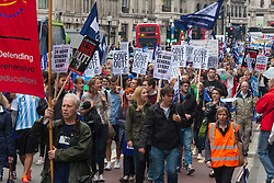 London, July 10th 2014. Thousands of striking teachers, government workers and firefighters marched through London in protest against cuts and working conditions.