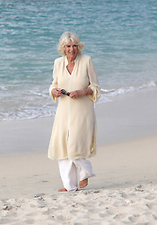 The Duchess of Cornwall walks along the Grand Anse beach during a one day visit to the Caribbean island of Grenada.