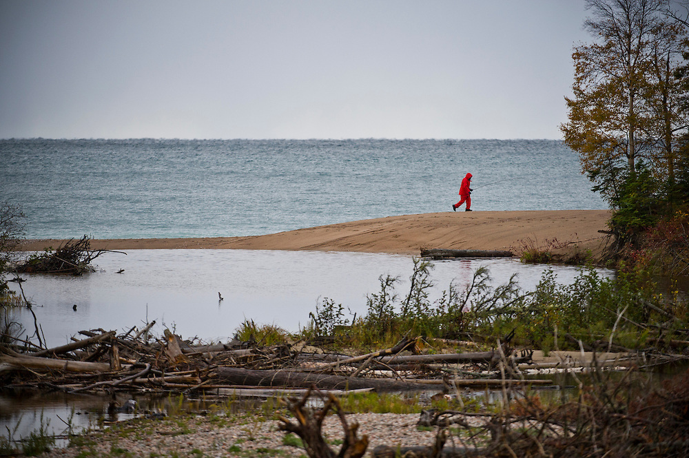 A fisherman on a Lake Superior beach at Old Woman Bay in Ontario Canada.