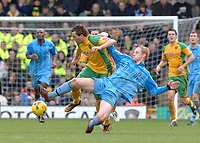 Photo: Ashley Pickering.<br />Norwich City v Coventry City. Coca Cola Championship. 24/02/2007.<br />Darren Huckerby of Norwich (yellow) is tackled by Andrew Whing of Coventry