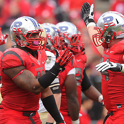 10 November 2012: Rutgers Scarlet Knights defensive end Marcus Thompson (48) and defensive tackle Scott Vallone (94) celebrate a sack during NCAA college football action between the Rutgers Scarlet Knights and Army Black Knights at High Point Solutions Stadium in Piscataway, N.J.. Rutgers defeated Army 28-7.