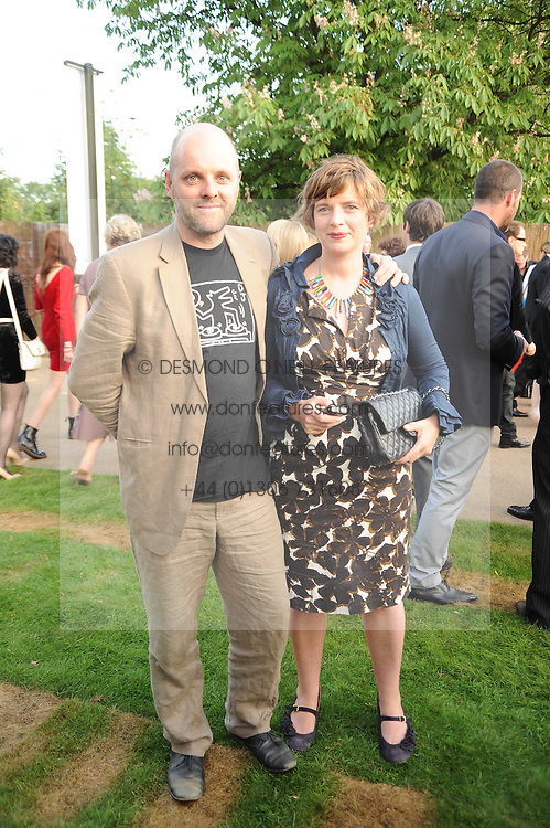 GAVIN TURK and his wife DEBORAH  at the annual Serpentine Gallery Summer party this year sponsored by Jaguar held at the Serpentine Gallery, Kensington Gardens, London on 8th July 2010.  2010 marks the 40th anniversary of the Serpentine Gallery and the 10th Pavilion.