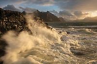 Waves crash over rocky coastline of Flakstadøy, Lofoten Islands, Norway
