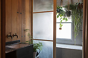 The wood paneled bathroom in architect Simon and Taeko Astridge's newly renovated Tufnell Park neighborhood London flat. CREDIT: Vanessa Berberian for The Wall Street Journal. BALANCE SHEET - Astridge