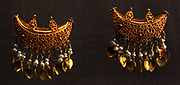 Byzantine jewellers used many decorative techniques including filigree, granulation, openwork and relief work.  Gold earrings, boat shaped with granulated decoration, Asia Minor, (Turkey).