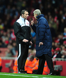 FILE PHOTO: Arsene Wenger is to leave Arsenal at the end of the season, ending a near 22-year reign as manager<br /><br />Arsenal manager Arsene Wenger shows his frustration towards the fourth official on the touchline ... Soccer - Barclays Premier League - Arsenal v Wigan Athletic - Emirates Stadium ... 16-04-2012 ... London ... United Kingdom ... Photo credit should read: Adam Davy/EMPICS Sport. Unique Reference No. 13320669 ...