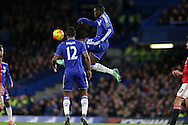 Kurt Zouma of Chelsea leaps to control the ball and then falls awkwardly leading to his injury. Barclays Premier league match, Chelsea v Manchester Utd at Stamford Bridge in London on Sunday 7th February 2016.<br /> pic by John Patrick Fletcher, Andrew Orchard sports photography.