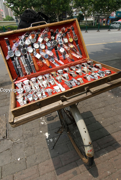 Fake designer watches for sale on a street in Shanghai