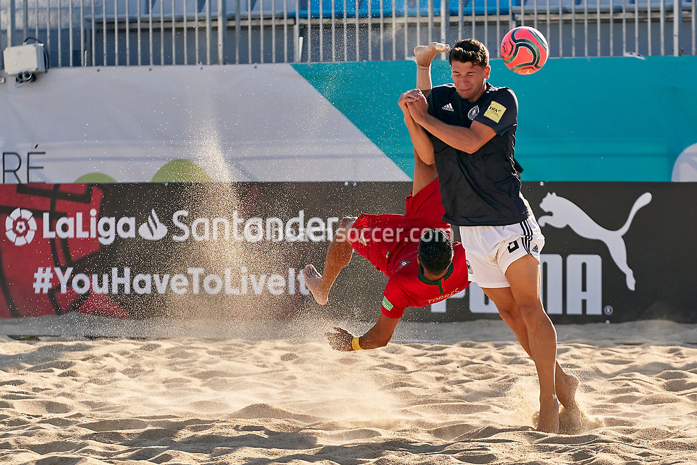 NAZARE, PORTUGAL - SEPTEMBER 3: Bruno Torres of Portugal and Marcel Nowak of Germany during day 2 of the Euro Beach Soccer League Superfinal at Estadio do Viveiro on September 3, 2020 in Nazare, Portugal. (Photo by Jose Manuel Alvarez/BSWW)