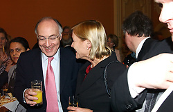 MICHAEL HOWARD and ANJI HUNTER at a party to celebrate the publication of Andrew Robert's new book 'Waterloo: Napoleon's Last Gamble' and the launch of the paperback version of Leonie Fried's book 'Catherine de Medici' held at the English-Speaking Union, Dartmouth House, 37 Charles Street, London W1 on 8th February 2005.<br />