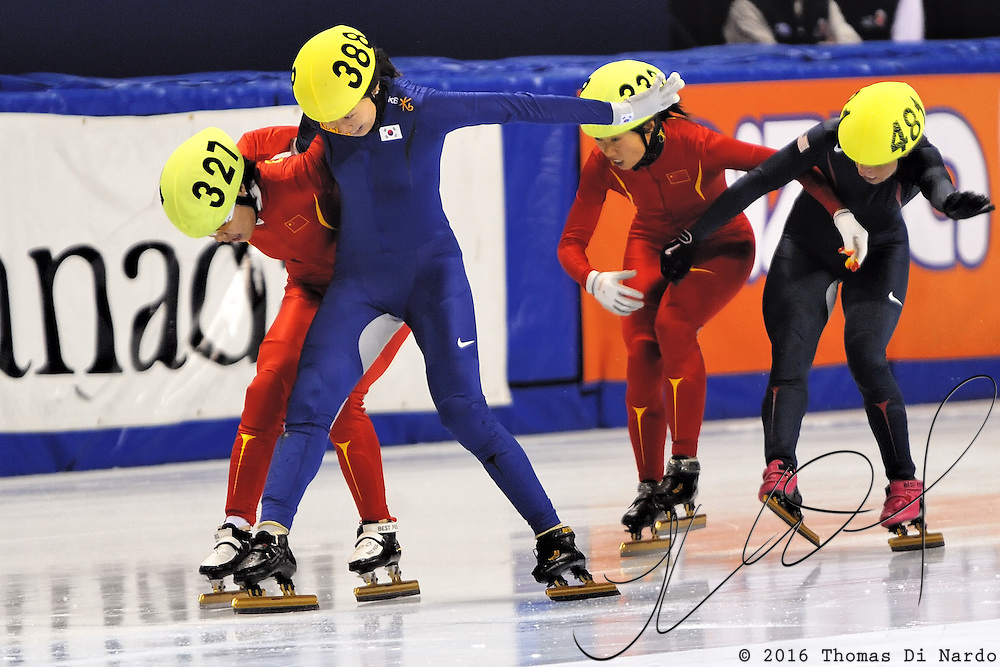 2008 World Cup Short Track - Vancouver - Shin Sea-Bom (KOR) snatches the Gold medal from Zhou Yang (CHN) while Allison Baver (USA) the Bronze from Zhang Hui during the 1000m (2) Ladies A Final.