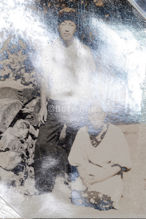 son and mother portrait with surface reflection Japan ca 1950s
