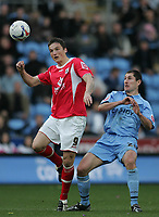 Photo: Lee Earle.<br /> Coventry City v Barnsley. Coca Cola Championship. 17/03/2007.Barnsley's Istvan Ferenczi (L) battles with Colin Hawkins.