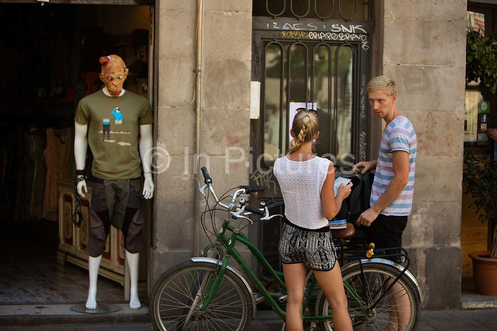 Fashion shop with masked mannequin gothic quarter, Barcelona, Spain.