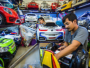 11 OCTOBER 2015 - BANGKOK, THAILAND: Toy vendors put together toy cars in the Saphan Lek market on what Bangkok city officials are saying was the last full day of business in the market. Many shops in the market are already closed. Street vendors and illegal market vendors in the Saphan Lek area will be removed in the next two weeks as a part of an urban renewal project coordinated by the Bangkok Metropolitan Administration. About 500 vendors along Damrongsathit Bridge, popularly known as Saphan Lek, have until Monday, October 11,  to relocate. Vendors who don't move will be evicted. Saphan Lek is one of several markets and street vending areas being closed in Bangkok this year. The market is known for toy and replica guns, bootleg and pirated DVDs and CDs and electronic toys.    PHOTO BY JACK KURTZ