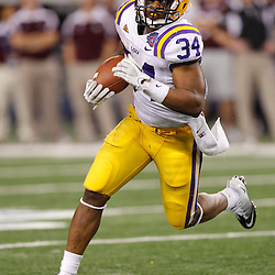 Jan 7, 2011; Arlington, TX, USA; LSU Tigers running back Stevan Ridley (34) runs against the Texas A&M Aggies during the fourth quarter of the 2011 Cotton Bowl at Cowboys Stadium. LSU defeated Texas A&M 41-24.  Mandatory Credit: Derick E. Hingle