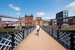 South Portland Street Suspension footbridge crossing River Clyde in Glasgow United Kingdom