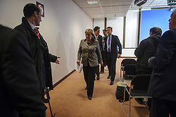 Angela Merkel, Germany's chancellor, departs from her press briefing,  at 02:26 Friday morning, as the first day of EU Summit meetings stretches into the next day, at the European Council headquarters in Brussels, Belgium on Friday, Dec. 14, 2012. (Photo © Jock Fistick)