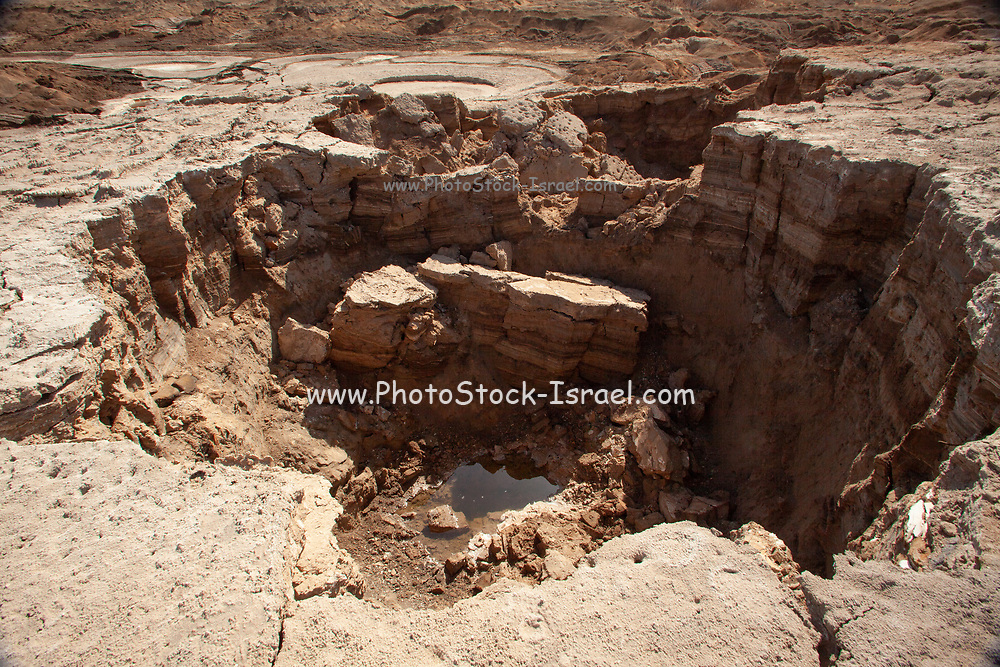 View of sink holes on the shore of the Dead Sea, Israel. The sink holes are caused by the rapidly receding water level (Approx. 5 cm per month)