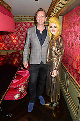 HAMISH MILLAR and PAM HOGG at a party to celebrate Pam Hogg receiving an honorary Doctorate from Glasgow University held at Park Chinois, 17 Berkeley Street, London on 11th July 2016.