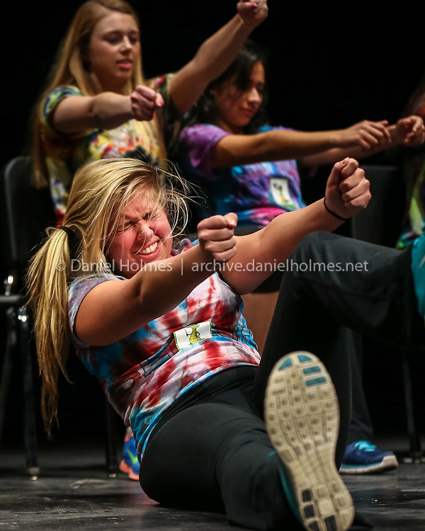 (3/10/14, WESTBOROUGH, MA) Westborough High senior Abby Correnti, front, and her friends are hypnotized to act like they are driving a car fast by hypnotist Dan Candell during a program at Westborough High School on Monday. Daily News and Wicked Local Photo/Dan Holmes