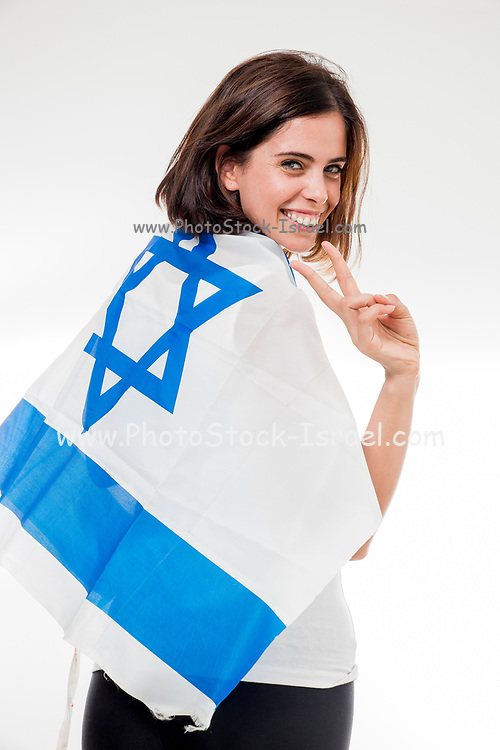 Portrait of a woman wrapped in the flag of Israel on white background