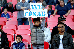 A general view of a young fan in the stands holding up a sign prior to the beginning the Carabao Cup Final at Wembley Stadium, London.