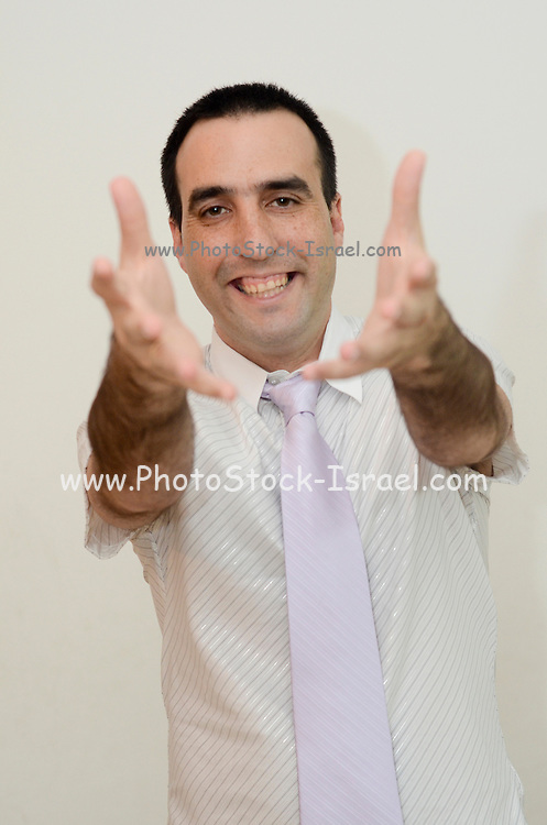 Young Man in his thirties with button down shirt and tie An offer gesture