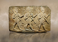 Photo of Hittite monumental relief sculpted orthostat stone panel of Herald's Wall Basalt, Karkamıs, (Kargamıs), Carchemish (Karkemish), 900-700 B.C. Anatolian Civilisations Museum, Ankara, Turkey. Military parade. Two helmeted soldiers in short skirts carry the shield on their backs and the spears in their hands. <br /> <br /> Against a brown art background. .<br />  <br /> If you prefer to buy from our ALAMY STOCK LIBRARY page at https://www.alamy.com/portfolio/paul-williams-funkystock/hittite-art-antiquities.html  - Type  Karkamıs in LOWER SEARCH WITHIN GALLERY box. Refine search by adding background colour, place, museum etc.<br /> <br /> Visit our HITTITE PHOTO COLLECTIONS for more photos to download or buy as wall art prints https://funkystock.photoshelter.com/gallery-collection/The-Hittites-Art-Artefacts-Antiquities-Historic-Sites-Pictures-Images-of/C0000NUBSMhSc3Oo