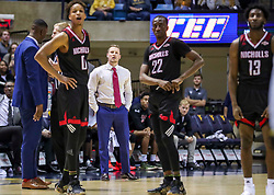 Dec 14, 2019; Morgantown, WV, USA; Nicholls State Colonels head coach Austin Claunch watches a foul shot after a technical foul was called on Nicholls State Colonels guard D'Angelo Hunter (0) during the second half against the West Virginia Mountaineers at WVU Coliseum. Mandatory Credit: Ben Queen-USA TODAY Sports