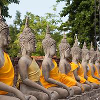 Row of Buddha statues around the stupa of Wat Yai Chai Mongkol in Ayutthaya.