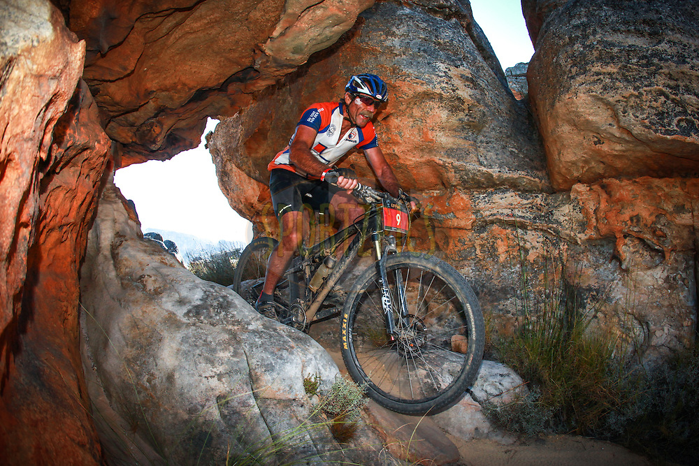 Mark Kapnoudhis winds his way through a sandstone arch during Stage 3 of the Momentum Health Tankwa Trek, presented by Biogen, on Sunday the 12th of February 2017.