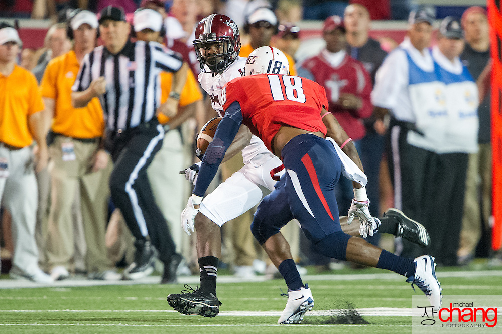 MOBILE, AL - OCTOBER 24: Wide receiver Bryan Holmes #18 of the Troy Trojans looks to maneuver by safety Terrell Brigham #18 of the South Alabama Jaguars on October 24, 2014 at Ladd-Peebles Stadium in Mobile, Alabama.  The South Alabama Jaguars defeated the Troy Trojans 27-13. (Photo by Michael Chang/Getty Images) *** Local Caption *** Bryan Holmes; Terrell Brigham