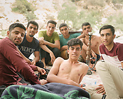 Group of friends camping near the waterfall. The Bisheh Waterfall is a waterfall in the village of Istgah-e Bisheh, Papi District in Khorramabad County, Iran. The waterfall is located 65 km (40 mi) from Khorramabad and near Bisheh railway station. With the nearby oak forest, it is a popular tourist attraction because of its scenic location and nearby train station.<br /> <br /> Travelling over 4000km by train across Iran. An opportunity to enjoy Persian hospitality, discover Iran's ancient cities and its varied landscapes, from deserts to mountains.