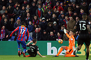 Karl Darlow , the goalkeeper of Newcastle United (R) saves a shot at goal from Christian Benteke of Crystal Palace (L). Premier League match, Crystal Palace v Newcastle Uutd at Selhurst Park in London on Sunday 4th February 2018. pic by Steffan Bowen, Andrew Orchard sports photography.