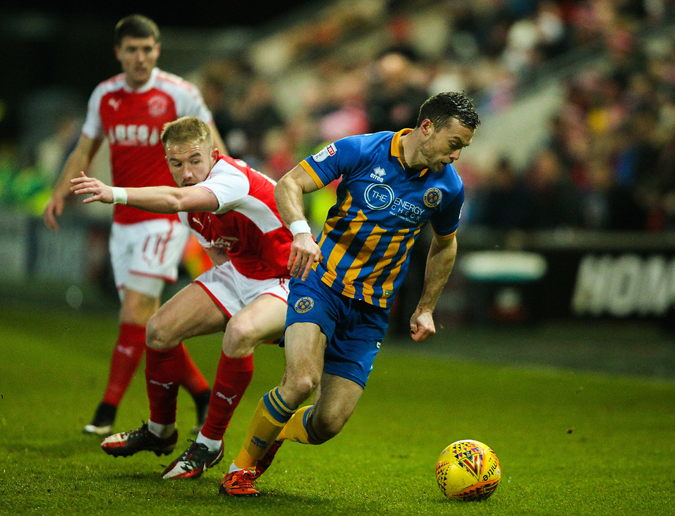 Shrewsbury Town's Shaun Whalley gets away from Fleetwood Town's Paddy Madden<br /> <br /> Photographer Alex Dodd/CameraSport<br /> <br /> The EFL Sky Bet League One - Fleetwood Town v Shrewsbury Town - Tuesday 13th February 2018 - Highbury Stadium - Fleetwood<br /> <br /> World Copyright © 2018 CameraSport. All rights reserved. 43 Linden Ave. Countesthorpe. Leicester. England. LE8 5PG - Tel: +44 (0) 116 277 4147 - admin@camerasport.com - www.camerasport.com