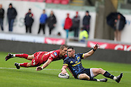 Ronan O'Mahony of Munster shakes off Liam Williams of the Scarlets (l) and scores his teams 2nd try. Guinness Pro12 rugby match, Scarlets v Munster at the Parc y Scarlets in Llanelli, West Wales on Saturday 3rd September 2016.<br /> pic by  Andrew Orchard, Andrew Orchard sports photography.