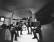 """8609-A56A Posed shot of """"The Redcoats"""", a rock band, on the stage of the Crystal Ballroom on West Burnside St. in downtown Portland. The clothing indicates a date of ca. 1966"""